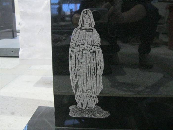 religious granite headstone