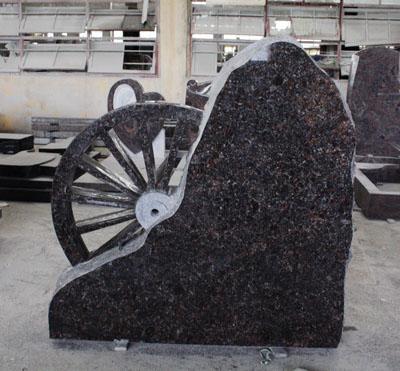 Tan Brown Custom Monument Wheel Carving