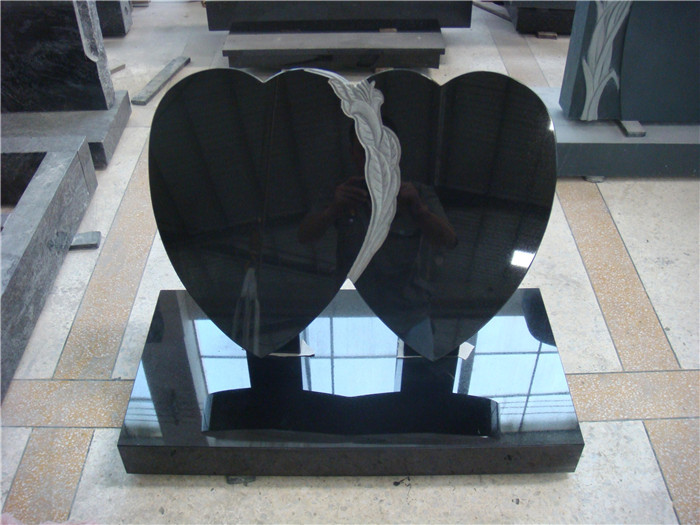 Double heart granite headstone with carving