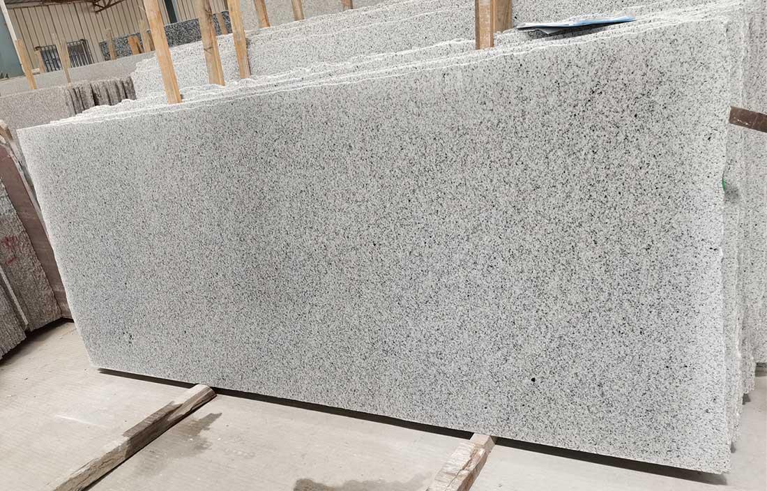 Bianco Tapaid Granite Slabs