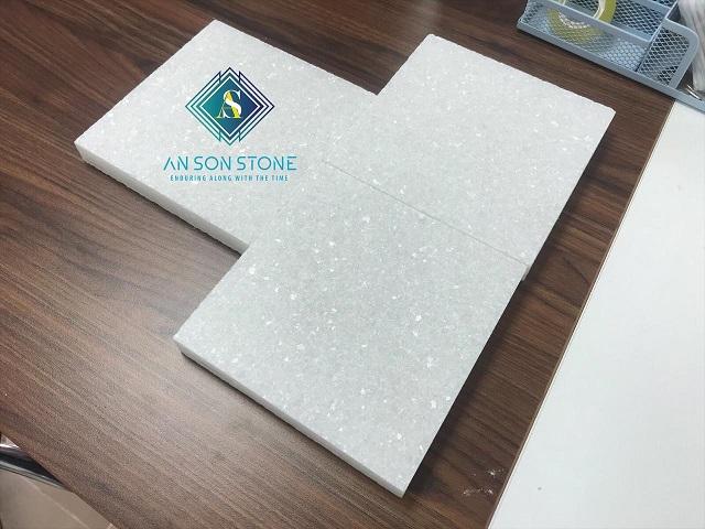 Top sandblasted white marble tile