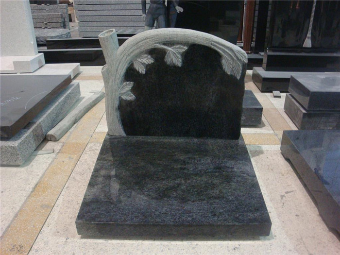 Black granite monument with tree carving