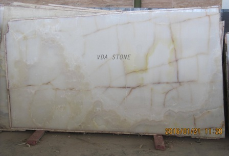 White Onyx Slabs with yellow lines