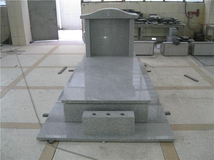 Grey granite headstone monument