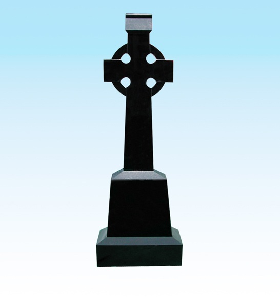 Religious granite headstone with cross carving