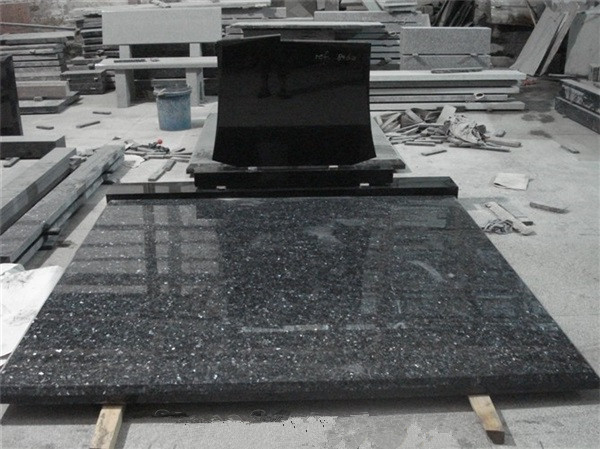 Black granite monument with slab