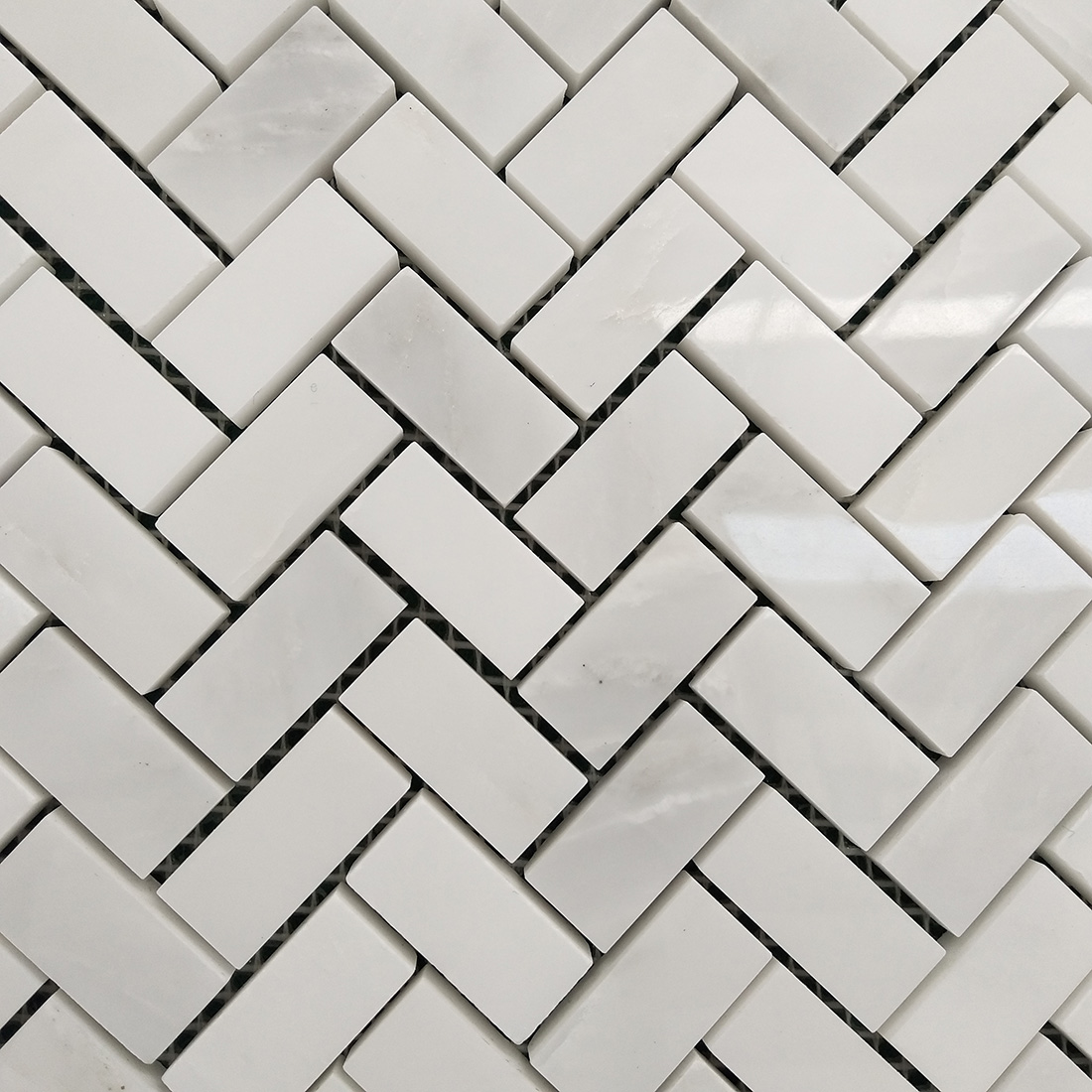 Herringbone wall and floor marble mosaic tiles