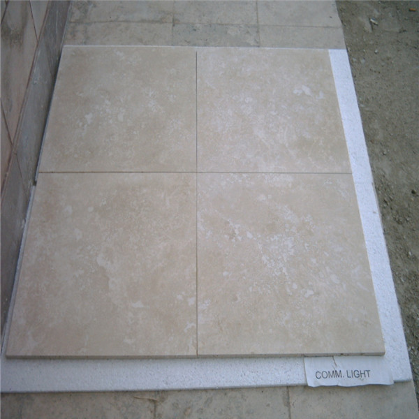 Beige travertine tiles polished