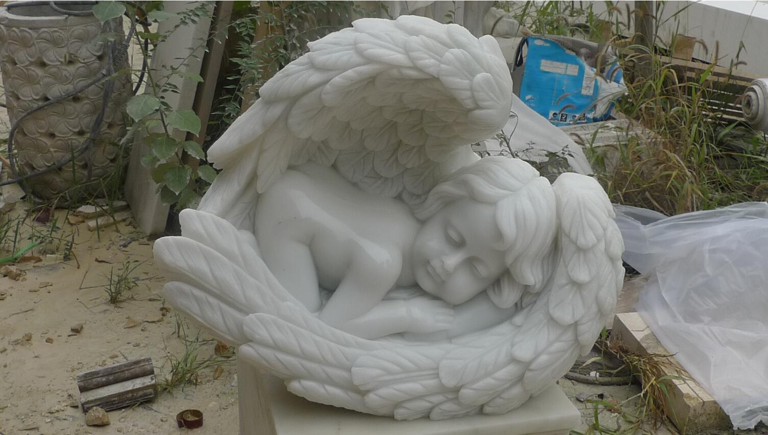 Carved marble sleeping baby statue