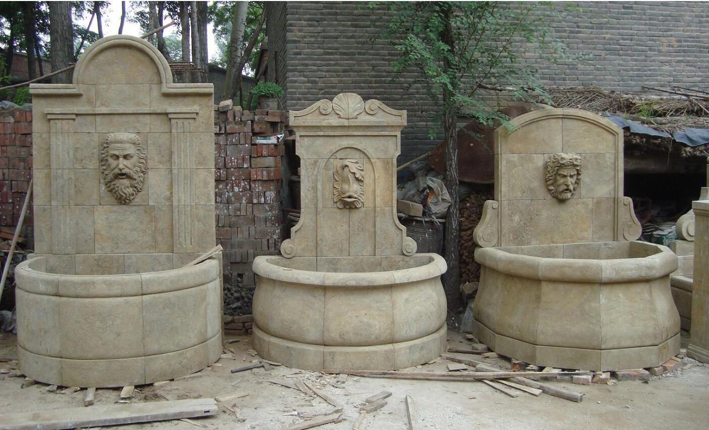 Antiqued stone garden sculpture wall fountains