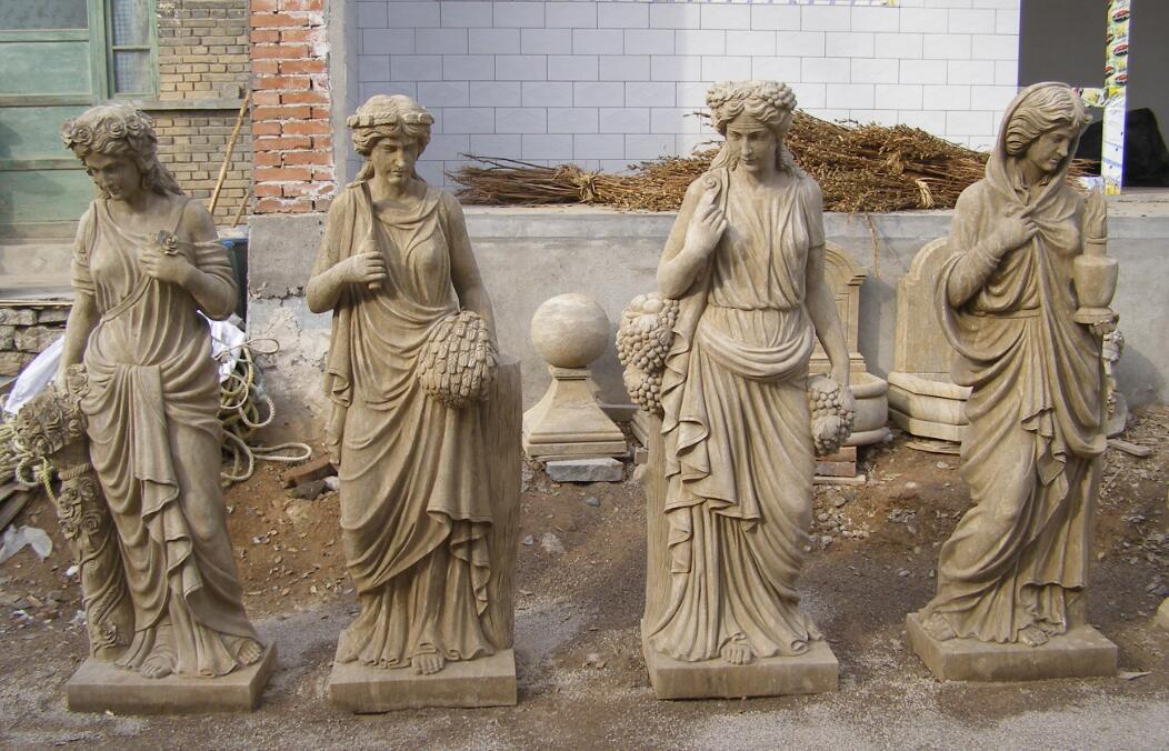 Antiqued stone sculptures human statues