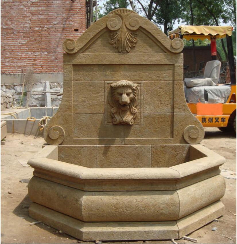 Antiqued stone lion sculpture wall fountain