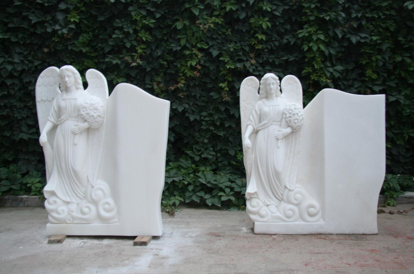 Carved tombstone angel sculpture