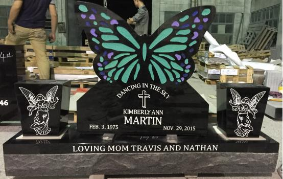 Black Marble Tombstones with Beautiful Butterfly