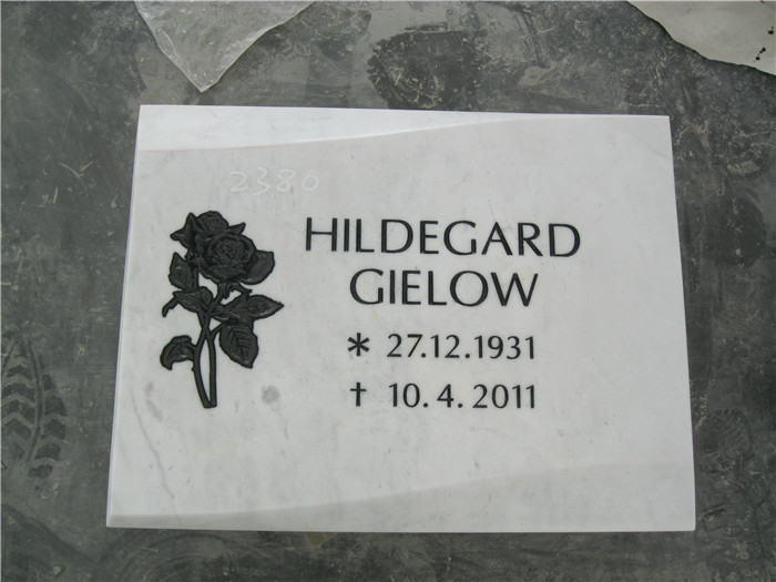 White Marble Headstone With Black Roes