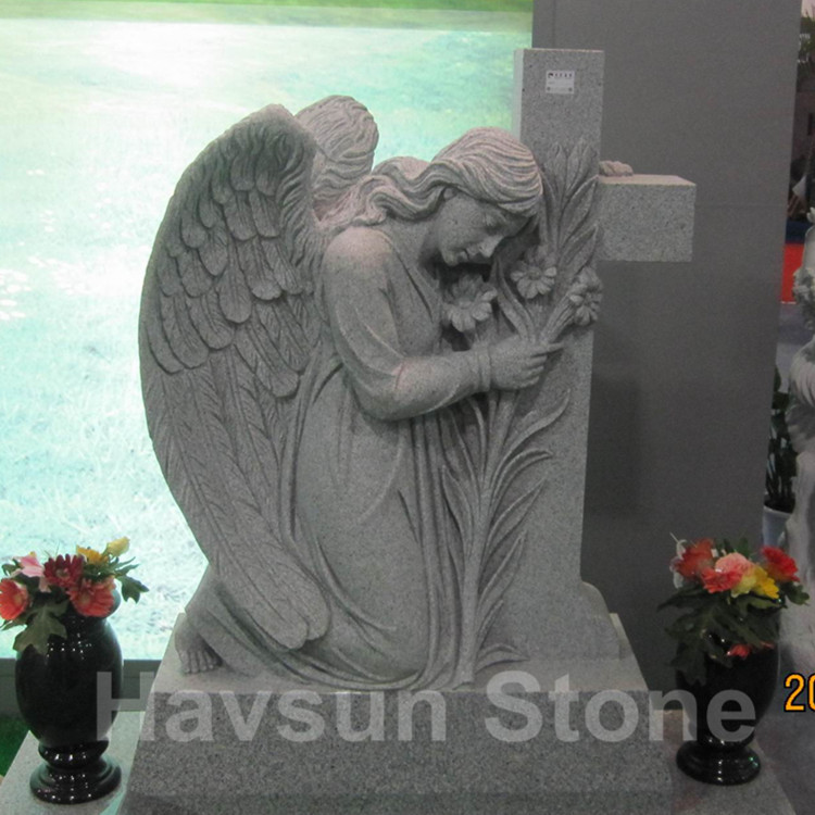 grey kneeling angel cross tombstone monument