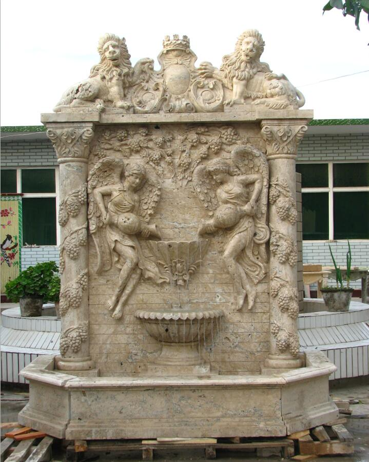 Hand carved traverti wall fountain with sculptures