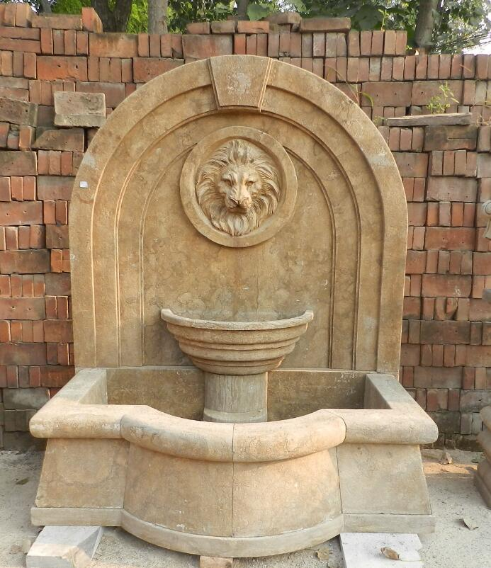 Antiqued stone wall fountain