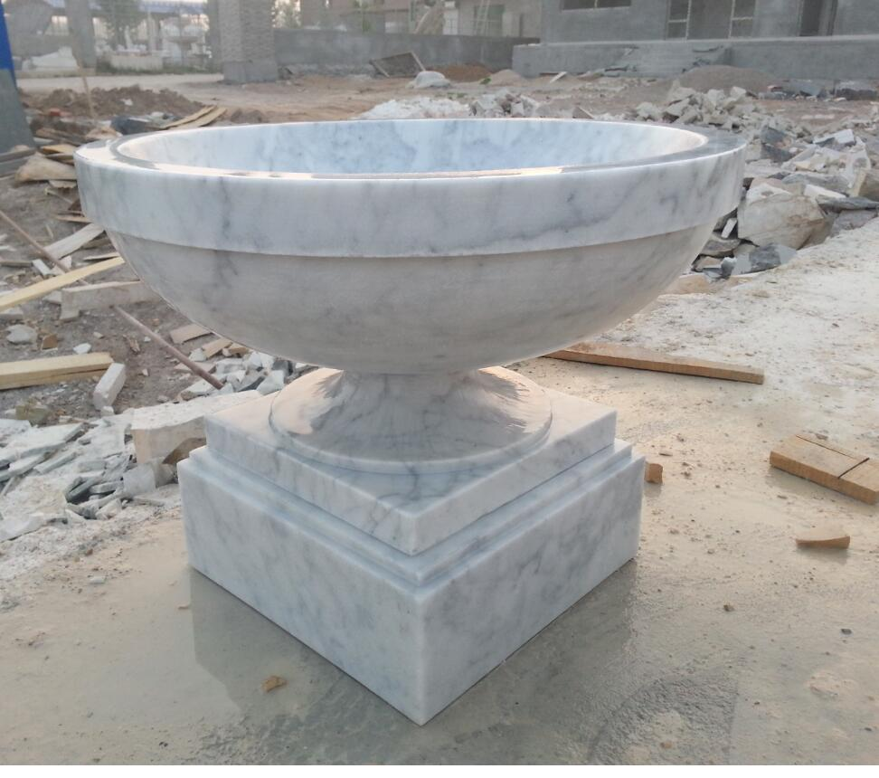 carved stone flower pot