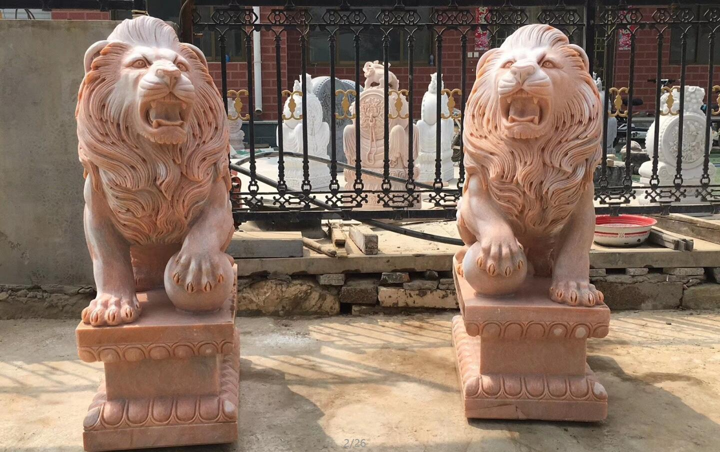 Carved stone lion sculptures sunset red marble