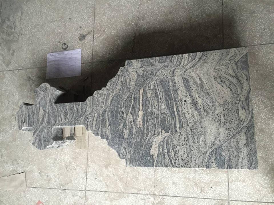 Grey stone tombstone