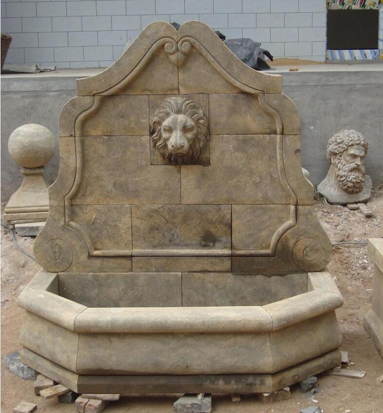 Antiqued stone garden wall sculpture fountain