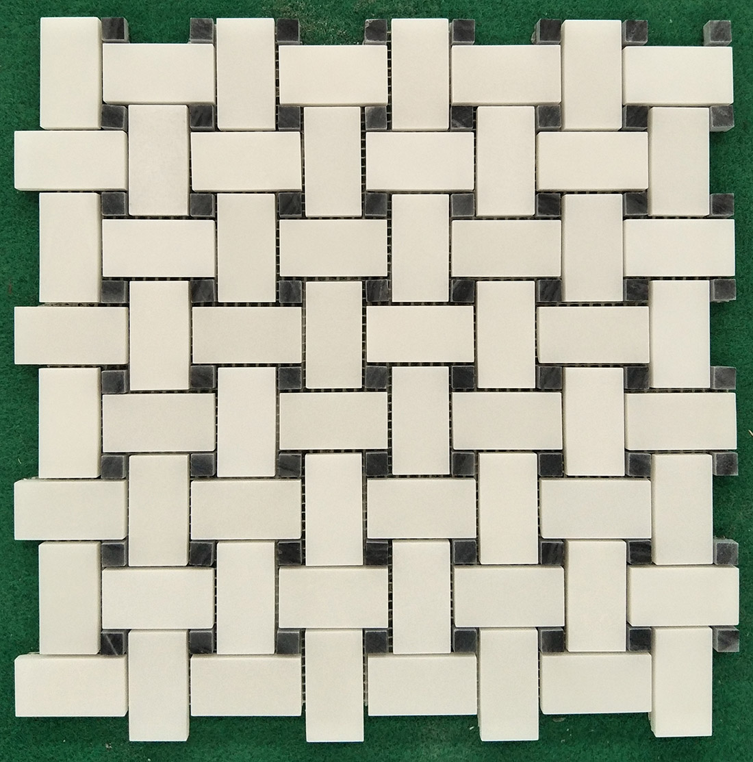 white and black basketweave mosaic tiles of natural marble