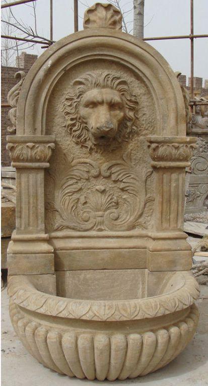 Antiqued stone lion sculpture garden wall fountain