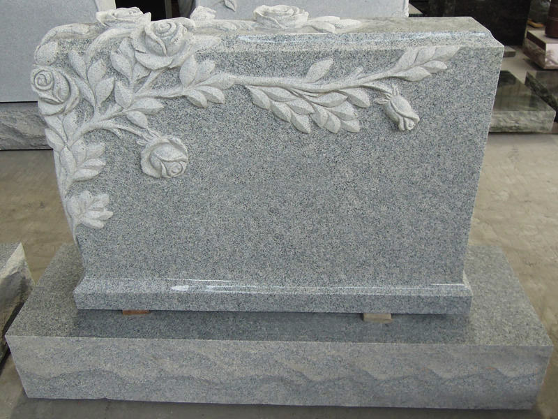 Grey Granite Stone Tombstones With Flowers