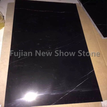 Shiny black granite tiles