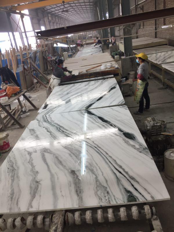 Panda White bookmatch slabs