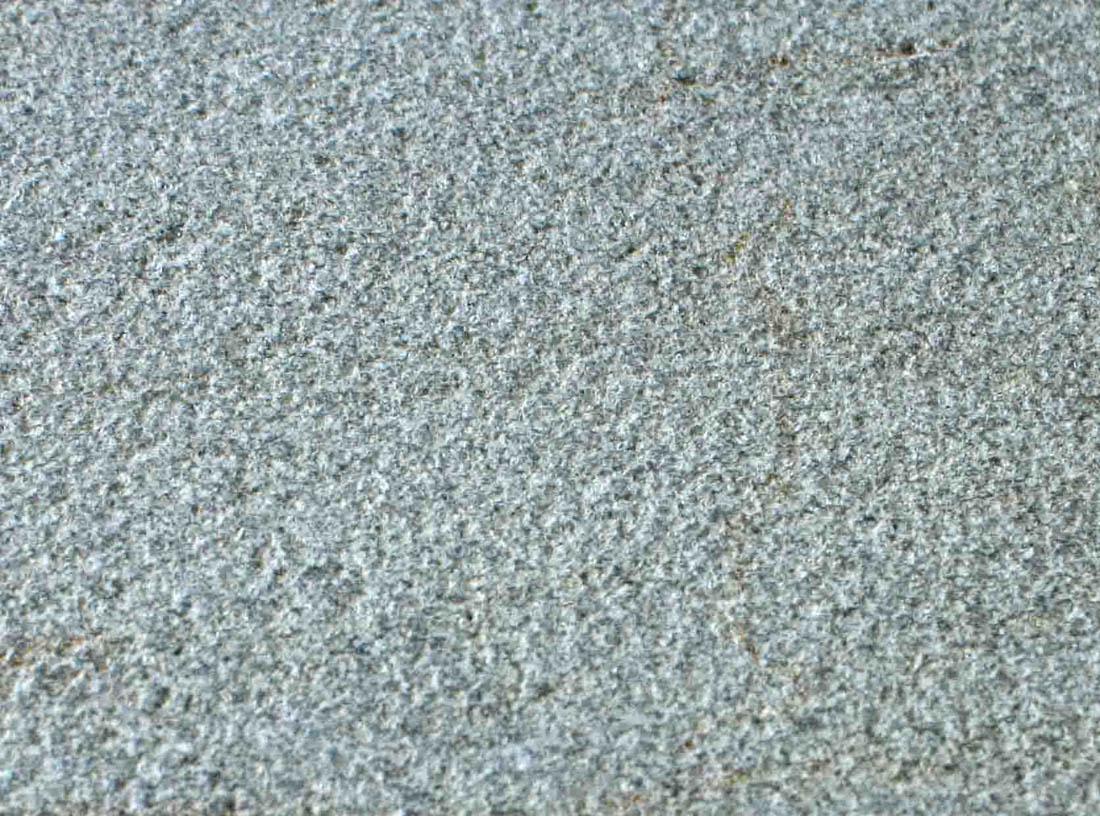 Bush hammered gray marble
