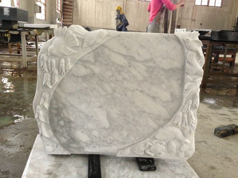 Carrara white tombstone with sculpture