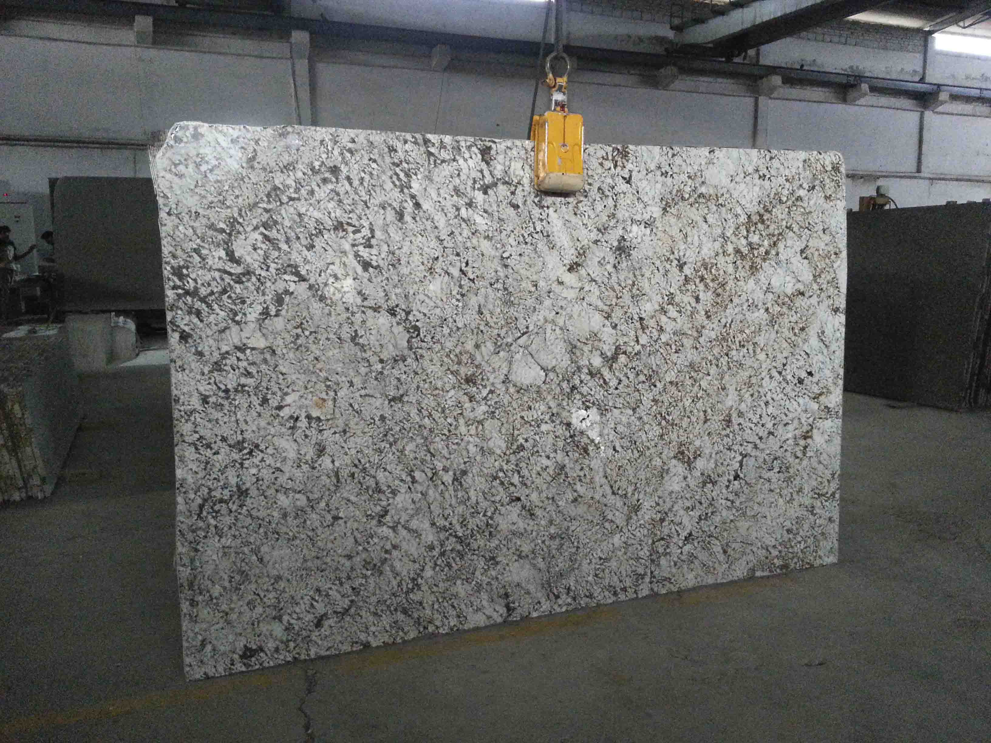 Crema Valencia Granite Slabs