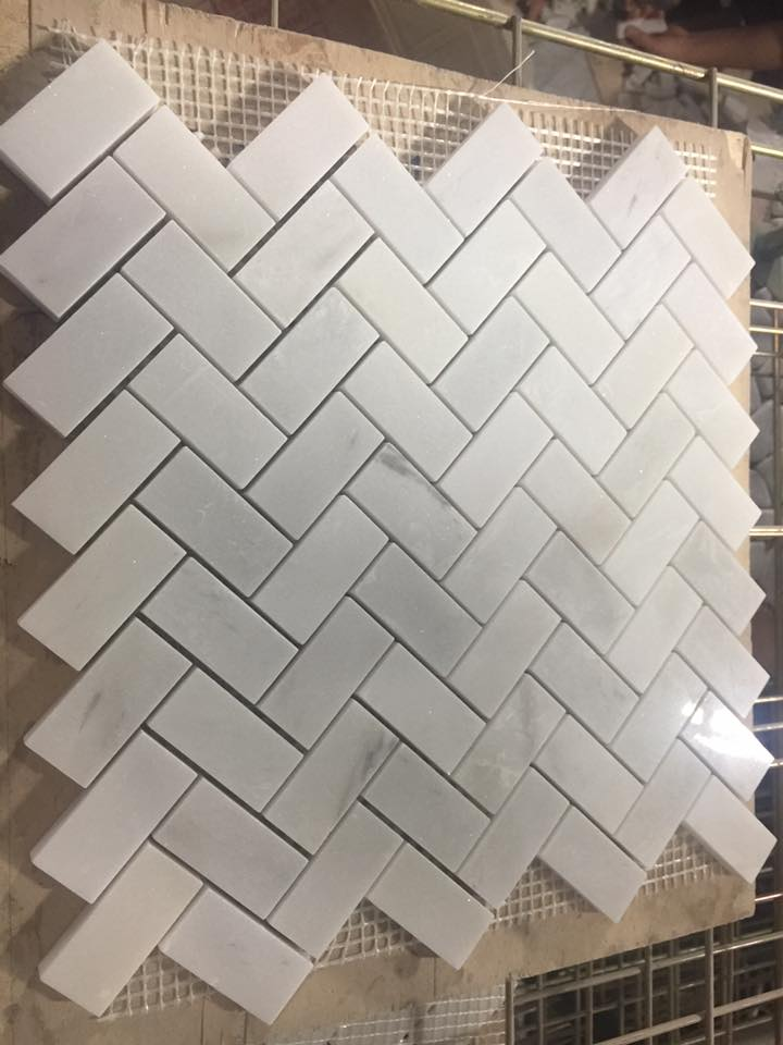 White herringbone mosaic tile