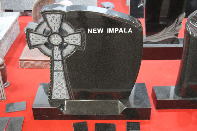 Impala Grey HeadstoneTombstone with Cross Flower Sculpture
