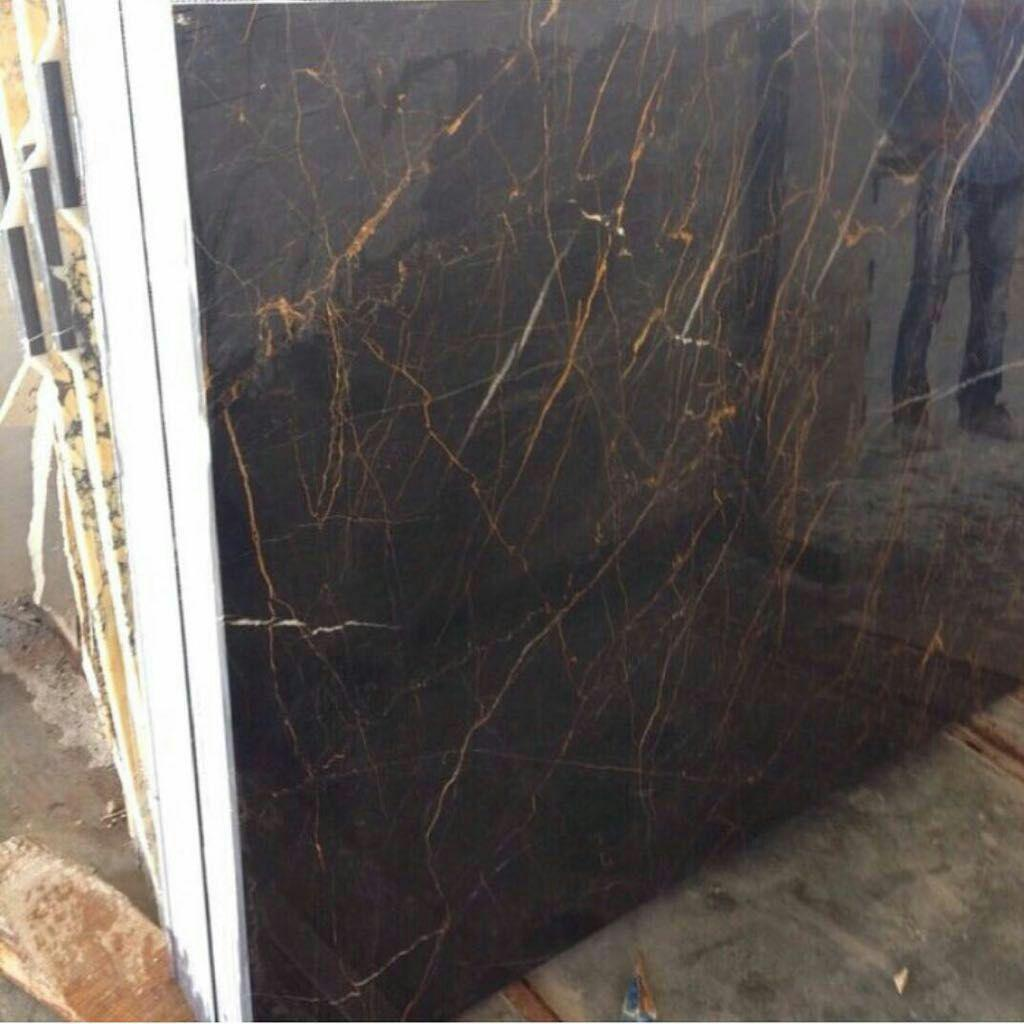 Golden black marble polished