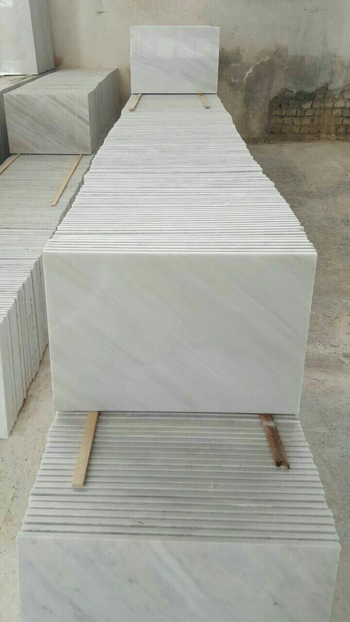 white snowy marble tile