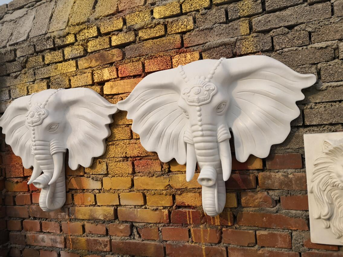 Carved white marble elephant statue wall hangings