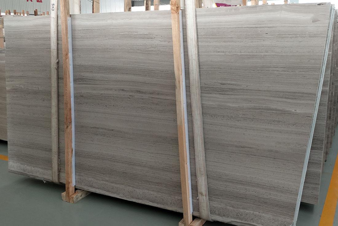 white woodvein marble slab